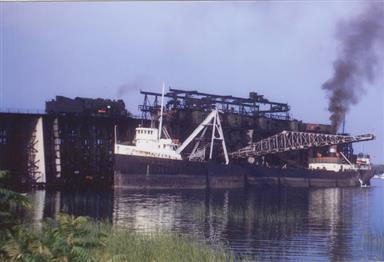 Great Lakes freighter loading coal at Sodus Point, 1950s